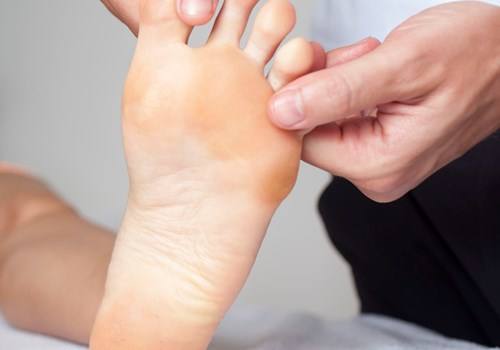 A podiatrist massaging a foot of a patient